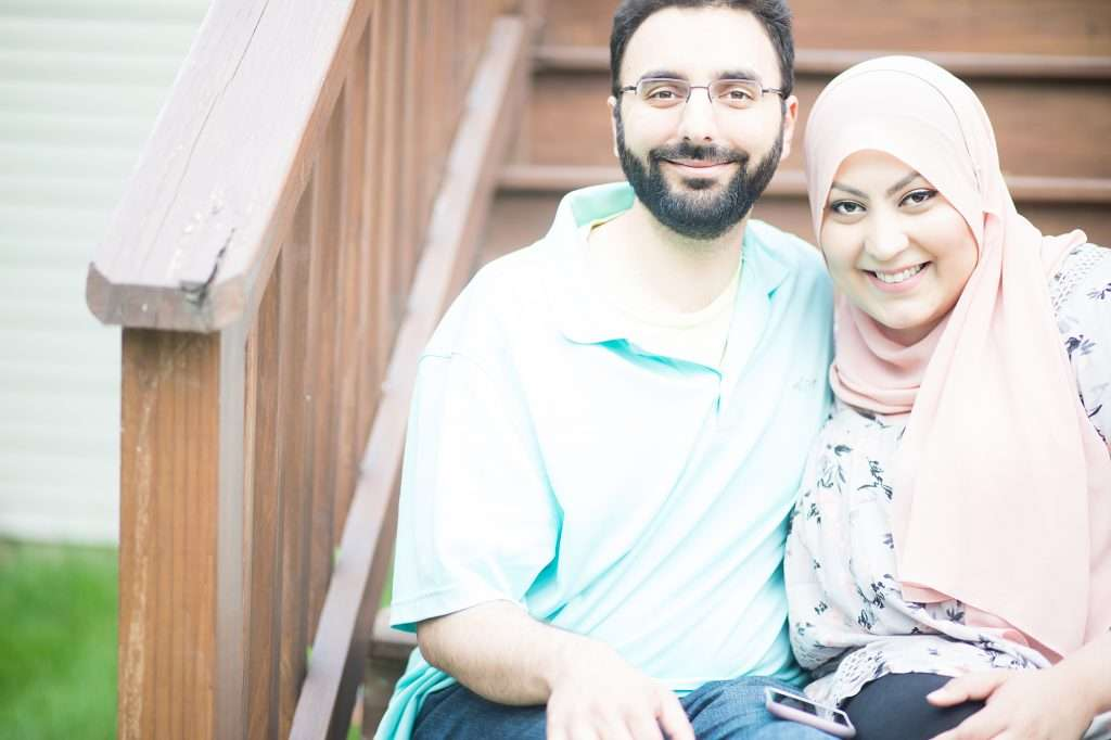 social media is a highlights reel. smiling husband and wife sitting on the deck steps